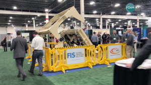 Mold carrier demonstration by an exhibitor